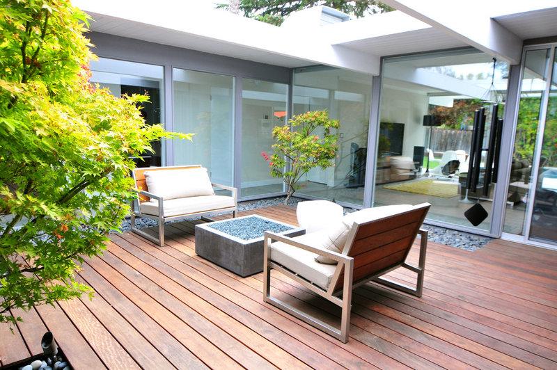 midcentury deck by Urbanism Designs