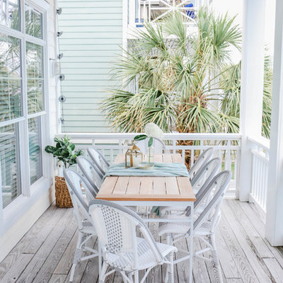 Inspiration for a mid-sized coastal deck remodel in Other with a roof extension