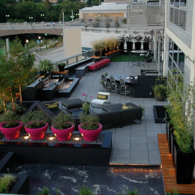 Deck container garden - large contemporary rooftop deck container garden idea in Charlotte with no cover