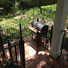 Traditional Deck by JOMA Construction