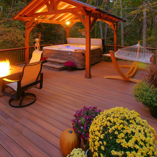 Deck - large traditional backyard deck idea in DC Metro with a fire pit