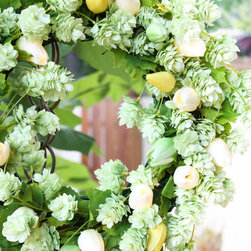 The Firefly Garden - Mint Tulip - Wreath - Give your front door a fresh look with glowing green, yellow, and white tulips accented with lush mint green hops blossoms in Mint Tulip. This gorgeous wreath is illuminated with tiny warm white LED lights that bring a subtle and welcoming glow to your entry.