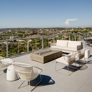 Inspiration for a contemporary rooftop outdoor kitchen deck remodel in San Diego with no cover