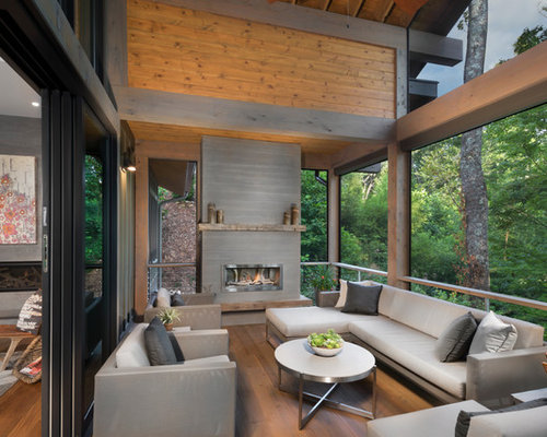 example of a trendy deck design in other with a fire pit and a roof extension - Ideas For Deck Design