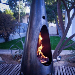 Modfire - Urbanfire - Reminiscent of a tipi, here is a modern firepit for any outdoor patio, regardless of style.