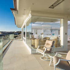 Beach Style Deck by Monarch Development and Design