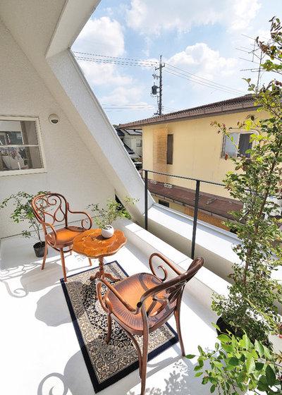 Ecléctico Terraza y balcón by Kentaro Kurihara