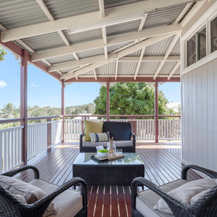 Scandinavian backyard deck in Brisbane with a roof extension.
