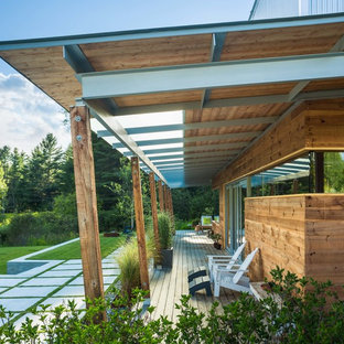 Inspiration for a scandinavian backyard deck container garden remodel in Burlington with a roof extension