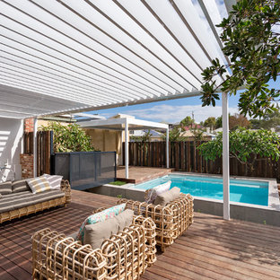 Mid-sized transitional backyard deck in Perth with a pergola.