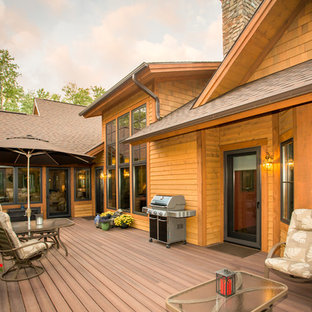 Large mountain style backyard deck photo in Other with no cover
