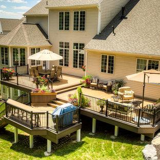 Idee per una grande terrazza tradizionale dietro casa con nessuna copertura