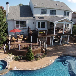 Multi-level deck design with outdoor kitchen and pool.