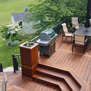 Deck - contemporary backyard deck idea in New York