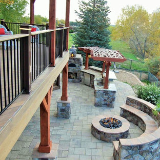 Deck - large southwestern backyard deck idea in Denver with a pergola