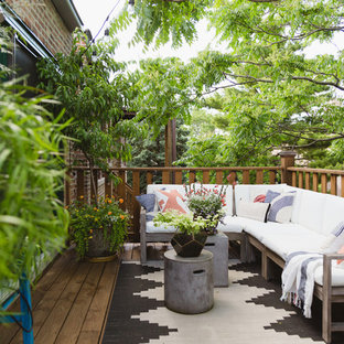 Example of an eclectic deck design in Chicago with no cover