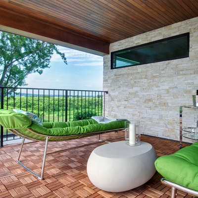 Deck - contemporary deck idea in Toronto with a roof extension
