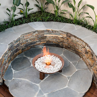 Mid-sized trendy backyard deck photo in Melbourne with a fire pit