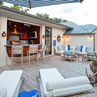 Outdoor kitchen deck - coastal rooftop outdoor kitchen deck idea in Jacksonville with no cover