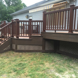 Inspiration for a large timeless backyard deck remodel in New York with no cover
