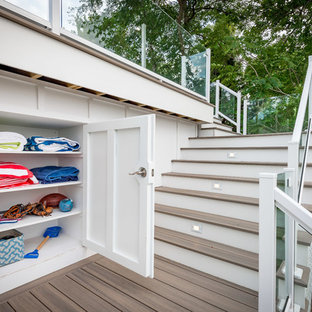 Example of a large beach style backyard deck design in Chicago