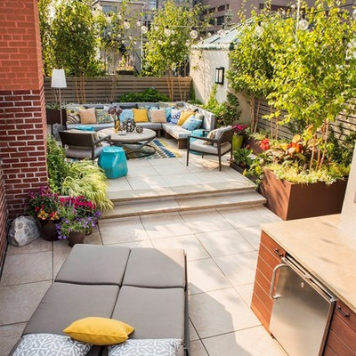 Outdoor kitchen deck - large modern rooftop outdoor kitchen deck idea in New York with no cover