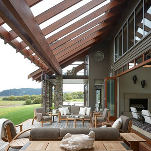 Inspiration for a transitional backyard deck remodel in Atlanta with a pergola