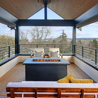 Mid-sized danish deck photo in Seattle with a fire pit and a roof extension