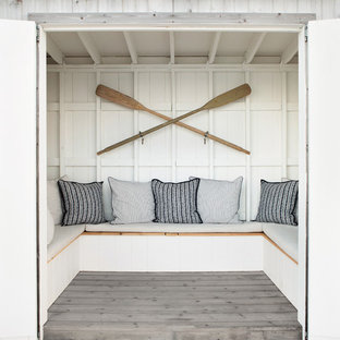 Design ideas for a small beach style backyard deck in New York with with dock.