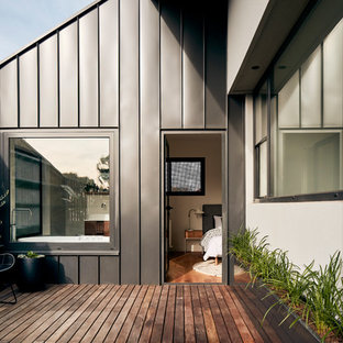 Diseño de terraza moderna, sin cubierta, en azotea, con jardín de macetas