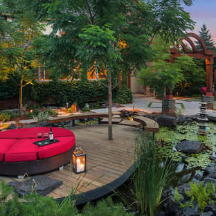 Inspiration for an asian backyard water fountain deck remodel in Minneapolis