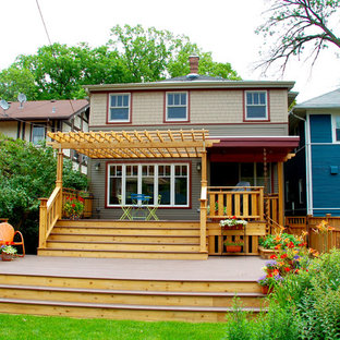 This is an example of a mid-sized arts and crafts backyard deck in Other with a container garden and a pergola.