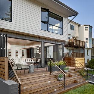 Imagen de terraza retro, de tamaño medio, sin cubierta, en patio trasero, con jardín de macetas