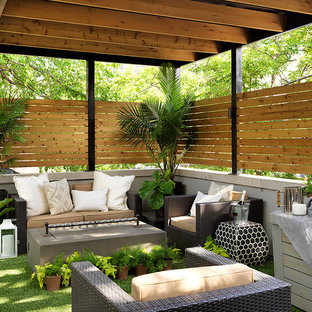 Deck container garden - traditional deck container garden idea in Chicago with a pergola