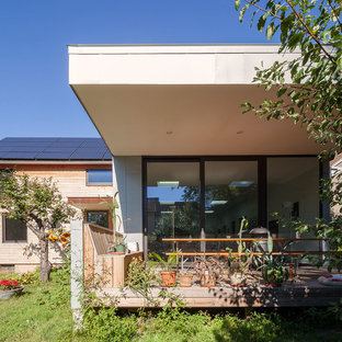 Medium sized scandi side terrace and balcony in Boston with a roof extension.
