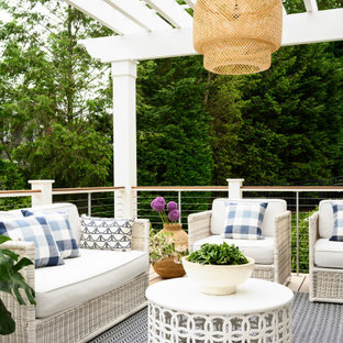Photo of a shabby-chic style deck in Boston.