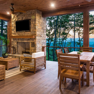 Inspiration for a country deck in Other with a fire feature.