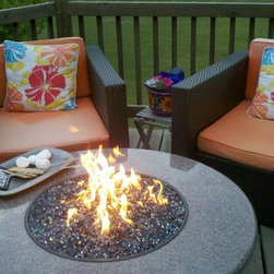 Oriflamme Fire Table - The Oriflamme Fire Table by Designing Fire featured on AllBackyardFun.com. Ever want to take the kids out to roast marshmallows but don't want to deal with chopping wood, light a fire, and smelling like smoke just for one Smore? The Oriflamme Fire Table is gas-fueled, with no smoke or embers to worry about. Plus, this firepit will be the center of your outdoor patio at all your parties and gatherings!
