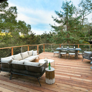 Photo of a large midcentury deck in San Francisco with no cover.