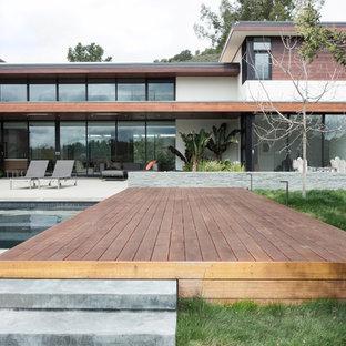 Idee per una terrazza minimalista dietro casa con fontane