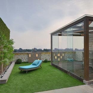 Esempio di una terrazza design di medie dimensioni e sul tetto