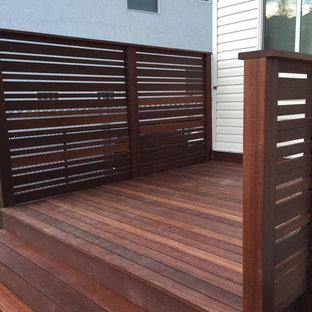 Deck - small transitional backyard deck idea in Calgary with no cover