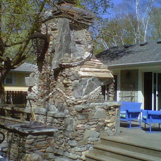Traditional Deck by Peterson Masonry Design