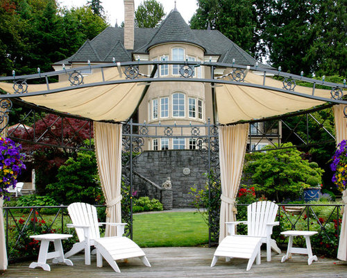 Example Of A Classic Deck Design In Portland With An Awning