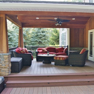 Example of a mid-sized arts and crafts backyard water fountain deck design in New York with a roof extension