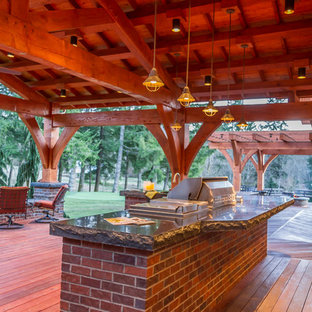 Example of a large arts and crafts deck design in Portland