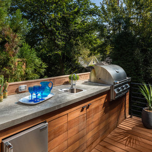 Inspiration for a large contemporary backyard outdoor kitchen deck remodel in Atlanta with no cover