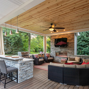 Inspiration for a transitional deck in Cleveland with with fireplace and a roof extension.