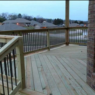 Mid-sized elegant backyard deck photo in Other