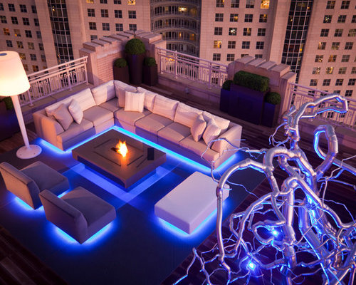 Example Of A Trendy Rooftop Deck Design In Dallas With A Fire Pit